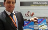 Kilic Deniz EVP Sinan Kiziltan showing the new valude-added range destined for the European market at the World Food 2014 expo in Moscow. Photo: Undercurrent News