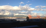 A container ship sails past the hotel hosting the 2014 IFFO conference in Vancouver. Matt Whittaker/Undercurrent News